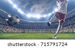 soccer player kicks the ball on ... | Shutterstock . vector #715791724