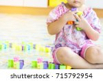 blur image of kid play the toys.... | Shutterstock . vector #715792954