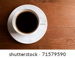 cup of coffee with smoke on brown background - stock photo