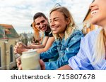 friends on rooftop party at... | Shutterstock . vector #715807678