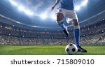 soccer player kicks the ball on ... | Shutterstock . vector #715809010