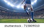 soccer player kicks the ball on ... | Shutterstock . vector #715809010