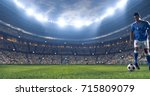 soccer player kicks the ball on ... | Shutterstock . vector #715809079