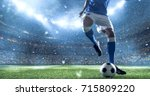 soccer player kicks the ball on ... | Shutterstock . vector #715809220