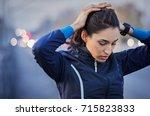 young runner taking a break... | Shutterstock . vector #715823833