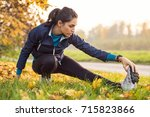 young woman exercising at park... | Shutterstock . vector #715823866