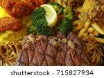 beef steak with brocolin ... | Shutterstock . vector #715827934