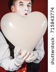 young mime artist with balloons ... | Shutterstock . vector #715843774