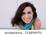 portrait of smiling beautiful... | Shutterstock . vector #715859470