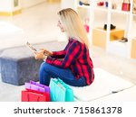 young blonde woman with long... | Shutterstock . vector #715861378