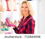 young blonde smiling attractive ... | Shutterstock . vector #715864048