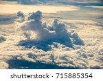 cloud from plane window view. | Shutterstock . vector #715885354