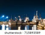 blurred tug boats harbor | Shutterstock . vector #715893589