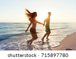 happy young couple enjoying the ... | Shutterstock . vector #715897780
