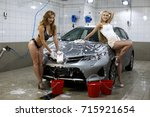 car wash. two sexy women washes ... | Shutterstock . vector #715921654