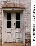 a weather beaten wooden door to ...   Shutterstock . vector #715924138