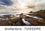 landscape selfie with tanah lot ... | Shutterstock . vector #715933390