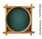 Small photo of Spirulina algae powder in a wooden cup isolated on white background. Top view. Super food concept