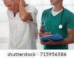 senior male patient suffering... | Shutterstock . vector #715956586