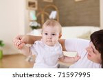 a young mother playing with her ... | Shutterstock . vector #71597995