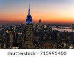 manhattan skyscrapers at dusk... | Shutterstock . vector #715995400