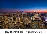 manhattan skyscrapers at dusk... | Shutterstock . vector #716000734