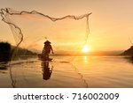 River Fishing With A Net Asian...