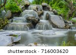 dreamy waterfall and rocks ... | Shutterstock . vector #716003620