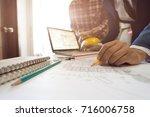 team architectman working new... | Shutterstock . vector #716006758