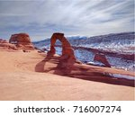 delicate arch in the winter | Shutterstock . vector #716007274