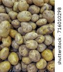 fresh potatoes from local wet... | Shutterstock . vector #716010298