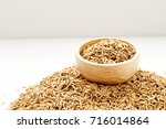 paddy seeds in wooden bowl on... | Shutterstock . vector #716014864