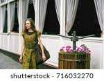 a young woman in the city | Shutterstock . vector #716032270