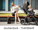 business woman with child in...