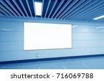 blank billboard on the wall in... | Shutterstock . vector #716069788
