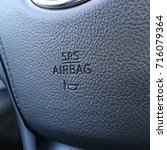 Small photo of Srs airbag logo on a cars steering wheel.