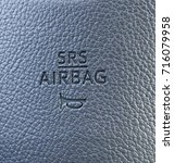 Small photo of Srs airbag logo on leather texture of cars steering wheel.