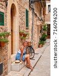 beautiful pretty woman walking... | Shutterstock . vector #716096200