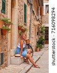 beautiful pretty woman walking... | Shutterstock . vector #716098294