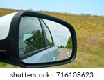 view from outside mirror of... | Shutterstock . vector #716108623