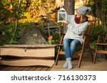 woman in a wool sweater and a... | Shutterstock . vector #716130373