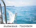 yacht sailing and vast blue sea | Shutterstock . vector #716143654