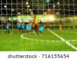 view from behind the goal of... | Shutterstock . vector #716155654