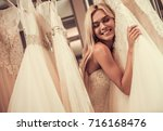 attractive young bride is... | Shutterstock . vector #716168476