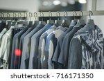 men urban clothing in a store... | Shutterstock . vector #716171350