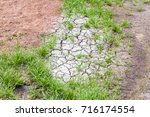 dry cracked ground due to... | Shutterstock . vector #716174554