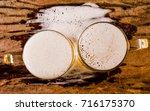 glass beer  top view on wood... | Shutterstock . vector #716175370