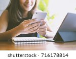 asian woman using smartphone... | Shutterstock . vector #716178814