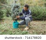 man worker in a plantation... | Shutterstock . vector #716178820