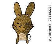 curious bunny cartoon   Shutterstock .eps vector #716182234